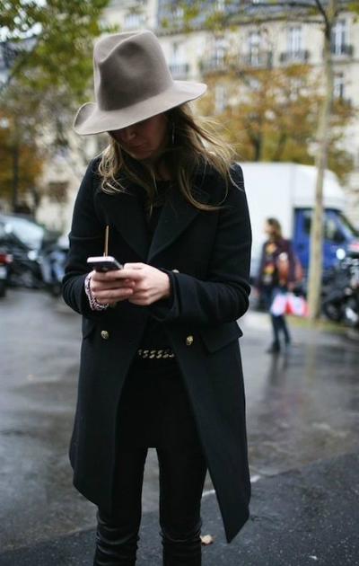 all black and a hat