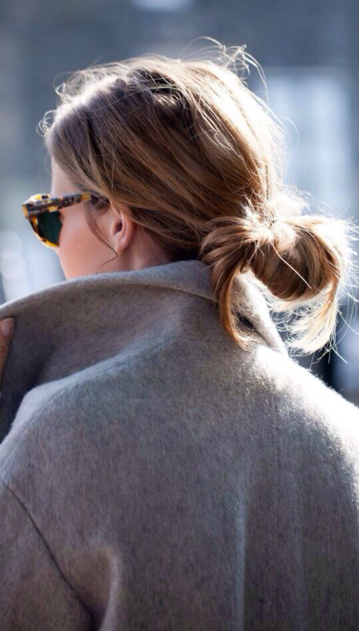 grey coat and loose bun